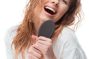 woman singing with hair comb