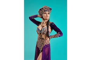 The beautiful sexy stylish brunette young woman as Cleopatra