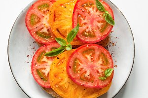 Tomatoes and basil on bread
