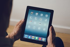 Man holding an apple ipad