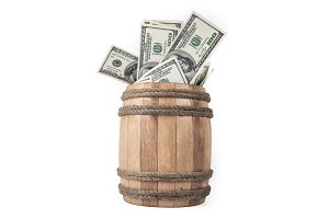 Wooden barrel with hundred dollar bills