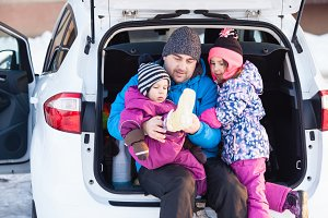 Dad with kids on winter vacation