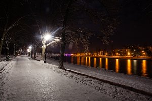 Night view of snow-covered embankment
