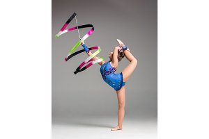 teenager doing gymnastics dance with ribbon