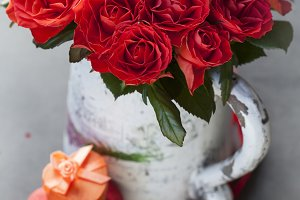 Scarlet red roses and gift boxes in heart shape. Shallow DOF