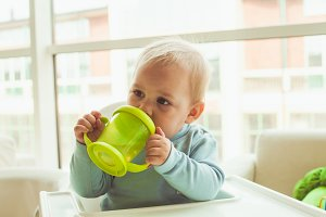 Little boy with baby cup