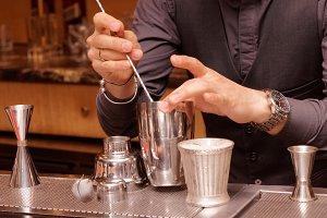 Bartender is mixing ingredients