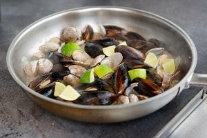 Clams and mussels on hot pan