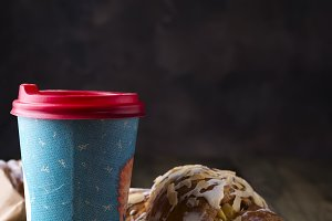 Coffee to go in a paper cup with croissants