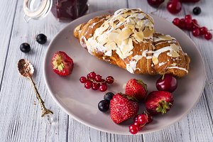 Croissants, corn flakes and berries