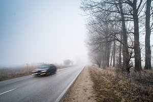 Car on a road in fog
