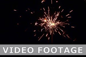 Sparklers slow mo. Christmas and New Year lights.