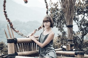 Portrait of happy young woman on the mountains background. Tropical island Bali, Indonesia. Lady in travel.