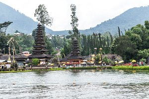 Pura Ulun Danu Bratan at sunrise, famous temple on the lake, Bedugul, Bali, Indonesia. View from the lake.