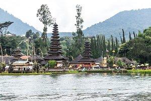 Pura Ulun Danu Bratan at sunrise, famous temple on the lake, Bedugul, Bali, Indonesia. View from the lake.