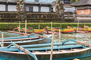 Colorful wooden fishing boats on the balinese temble background. Tropical magic island Bali, Indonesia.