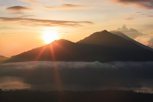 Active volcano. Sunrise from the top of Mount Batur - Bali, Indonesia