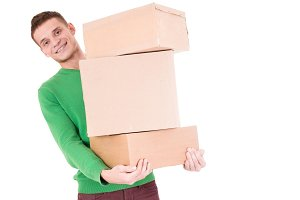Young delivery man hold boxes. so funny. isolated white background.