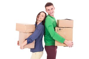 Happy smiling delivery man and woman carrying boxes isolated on white background