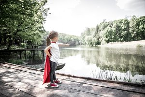 little cute girl in costume of a super hero