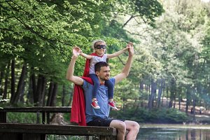 father and daughter playing a super hero