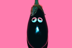 Eggplant with funny eyes.