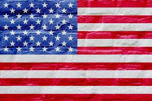 American flag over brick wall