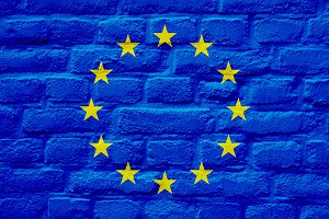 European flag over brick wall