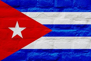 National Cuban flag over brick wall