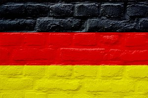 German flag over brick wall