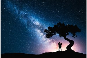 Milky Way with hugging couple under the tree