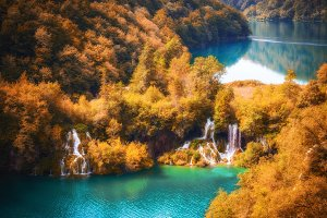 Autumn lake and waterfall