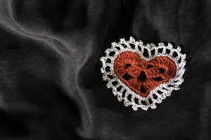 Heart shape made of red textile