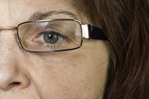 Close up old women eye and glasses