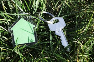 Shape of a house on grass and keys