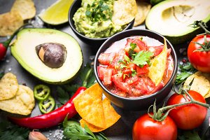 Latinamerican food party sauce guacamole, salsa, chips and ingre