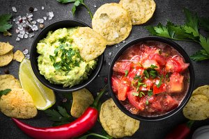 Traditional latinamerican mexican sauce guacamole and salsa on b