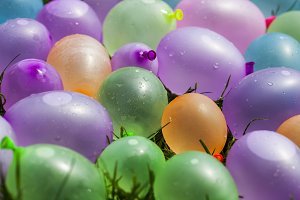 Summer fun concept: colorful water balloons, background