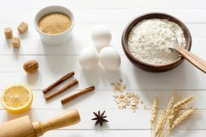 Baking ingredients on white table