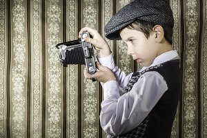 Child taking pictures with vintage c