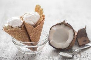 Vanilla-coconut ice cream in a waffle cone