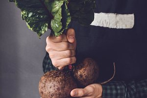 Farmer holding beetroot