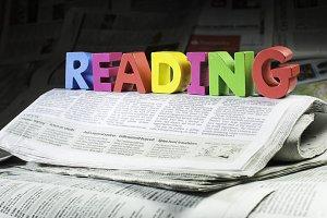 Word read on newspaper