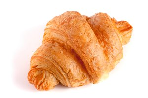 one croissant isolated on white background closeup