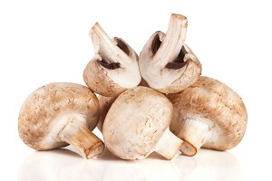 A bunch of champignon mushrooms isolated on white background