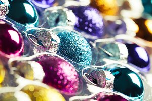 Bright multicolored christmas balls in rows, toned