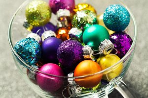 Bright multicolored christmas balls in transparent cup