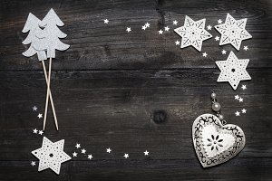 Christmas wooden background with silver colored decorations