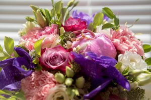 Wedding bouquet with golden rings, macro