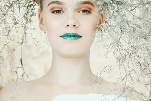 Fashion portrait of Young blond woman.Beautiful Girl with green lips